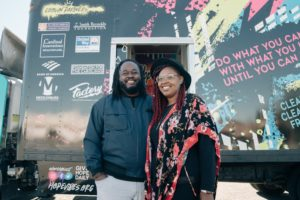Hope Vibes nonprofit founders Emmanuel and Adrienne Threatt in front of Hope Tank vehicle